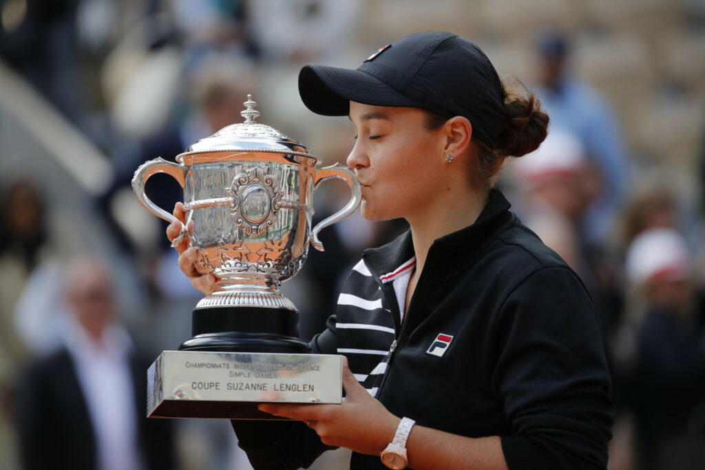 Ash Barty kisses the trophy after winning her first major championship, beating Marketa Vondrousova 6-1, 6-3 in the French Open final on Saturday in Roland Garros Stadium in Paris.
