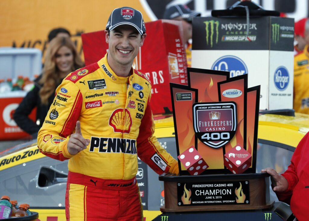 Joey Logano celebrates after winning the NASCAR Cup Series race at Michigan International Speedway on Monday in Brooklyn, Michigan.