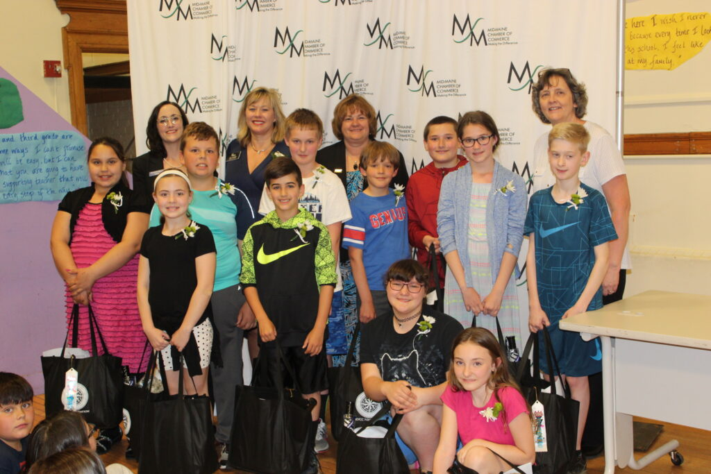 Albert S. Hall School perfect attendance students were honored June 14 at the Watervilel school. Kneeling from left are Jayda Dunn and Theresa Bickford. Second row from left are Kierstyn Glidden, Ava Fortuna, Forrest Poulin, Hunter Willett, Derek Couture, Ilya Ansdell, Daniel Joler, Kyleigh Parker and Trevor Tardif. Back from left are Kristine Black, of Bangor Savings Bank; Michele Prince, of Waterville Rotary Club; Kimberly Lindlof, of Mid-Maine Chamber of Commerce; and Principal Barbara Jordan.