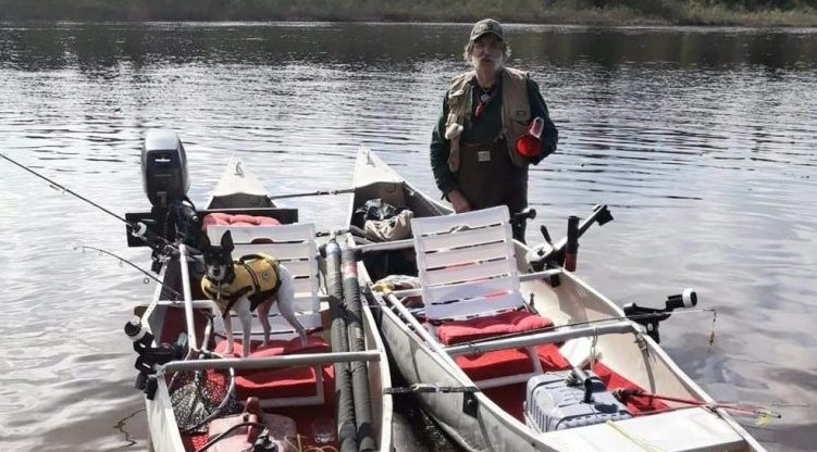 Michael Fiori is seen with a pair of tandem canoes in the wilderness of northern Maine on Monday,  just  hours before he and his brother Larry ended up in a fight for their lives when the canoes capsized in 50-degree water.