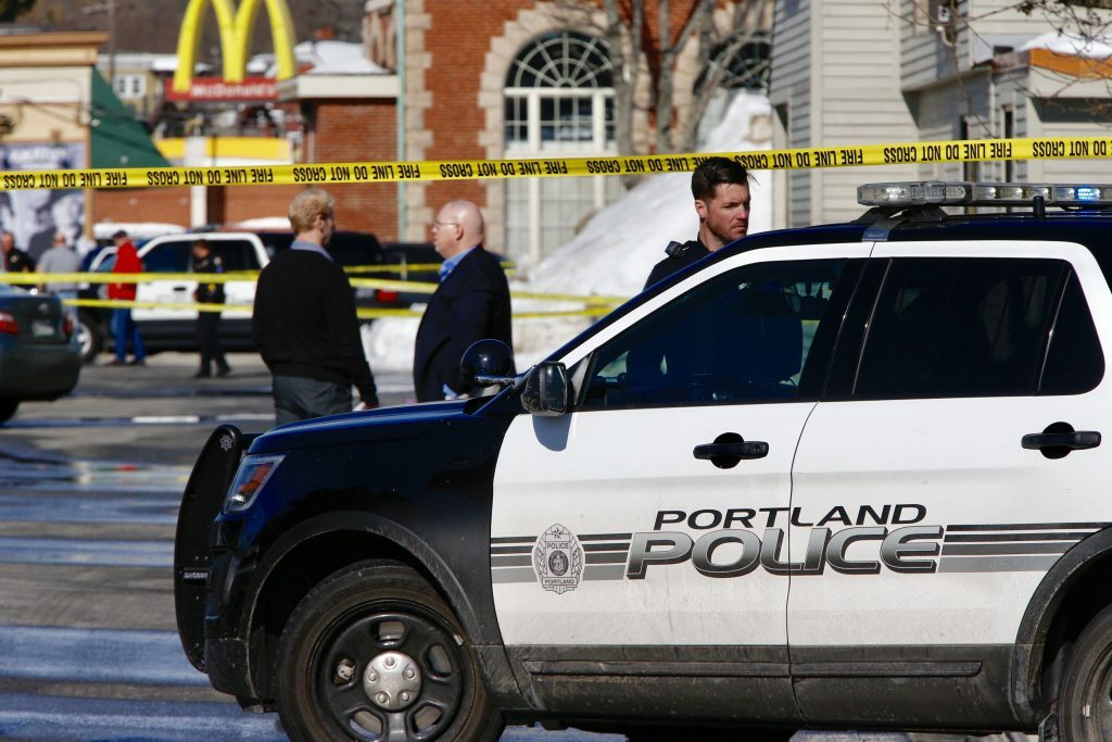 Police officers block off the scene where an officer shot Chance Baker at Union Station Plaza in Portland in February 2017.