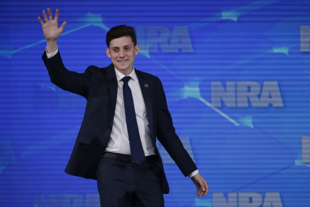 Kyle Kashuv, a survivor of the Marjory Stoneman Douglas High School shooting in Parkland, Fla., speaks at the National Rifle Association Institute for Legislative Action Leadership Forum in Indianapolis on April 26. Michael Conroy/Associated Press