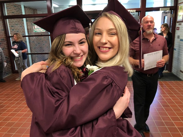 Regional High School Class of 2019 President Alyssa Stankevitz, right, hugs her best friend and fellow senior, Remington Shaw, Friday in the school lobby, before commencement exercises in which Stankevitz gave a speech.