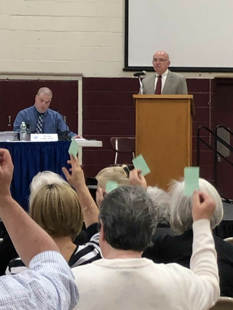 Richmond Town Manager Adam Garland, left, and Town Meeting moderator William Dale watch town residents vote at the annual Town Meeting Tuesday.