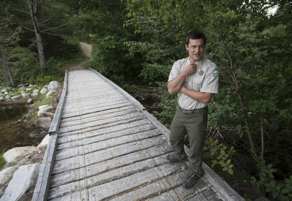 Baxter State Park Director Eben Sypitkowski waits to cross a snowmobile bridge at Abol Stream on his way to inspect recent trail improvements at the park last August, two months after he took over as director.