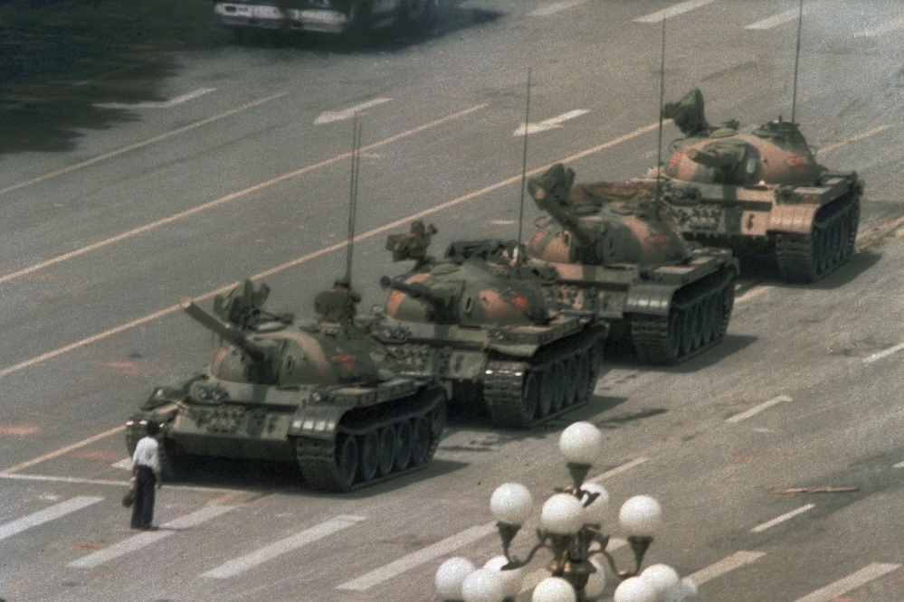 AP file photo A MAN ALONE: In this June 5, 1989, file photo, a Chinese man stands alone to block a line of tanks heading east on Beijing's Changan Boulevard from Tiananmen Square in Beijing. A quarter-century after the Communist Party's attack on demonstrations centered on Tiananmen Square on June 4, 1989, the ruling party prohibits public discussion and 1989 is banned from textbooks and Chinese websites.