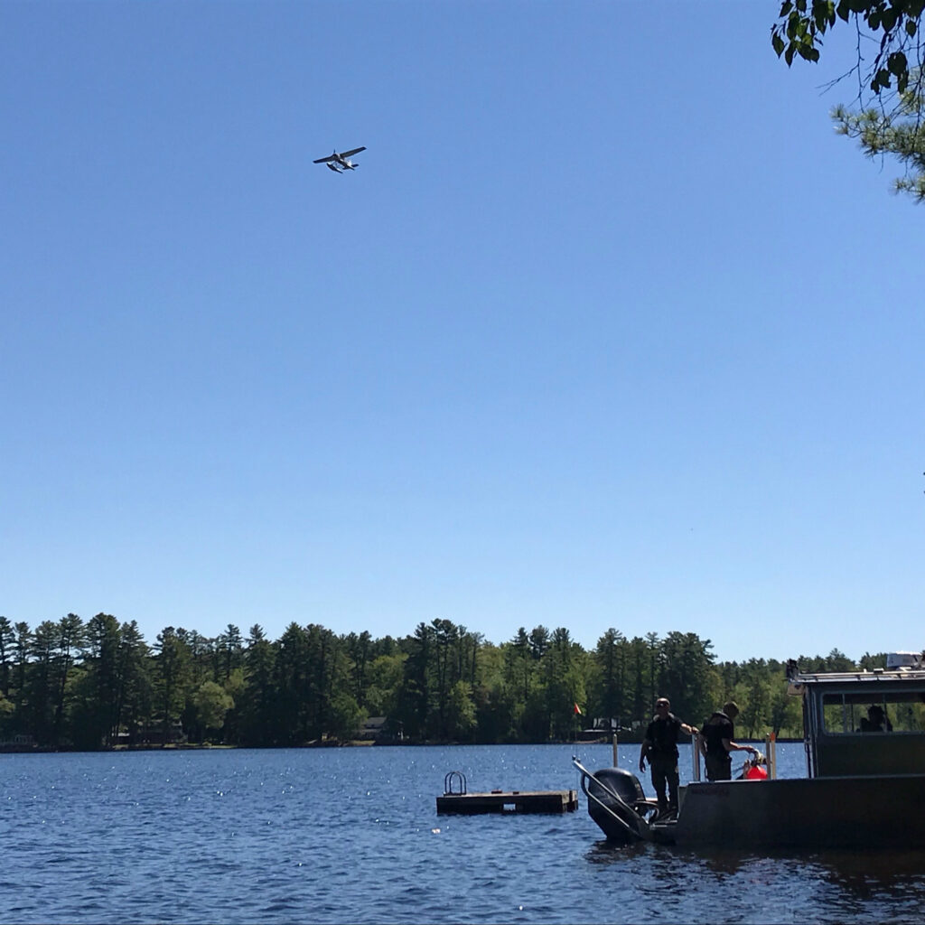 Maine Warden Service dive boat and aircraft on Watchic Lake on Saturday.
