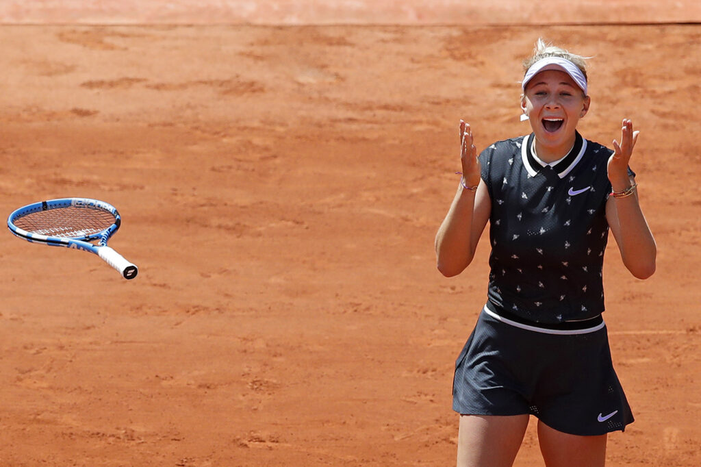 Amanda Anisimova of the U.S. celebrates winning her quarterfinal over Romania's Simona Halep.