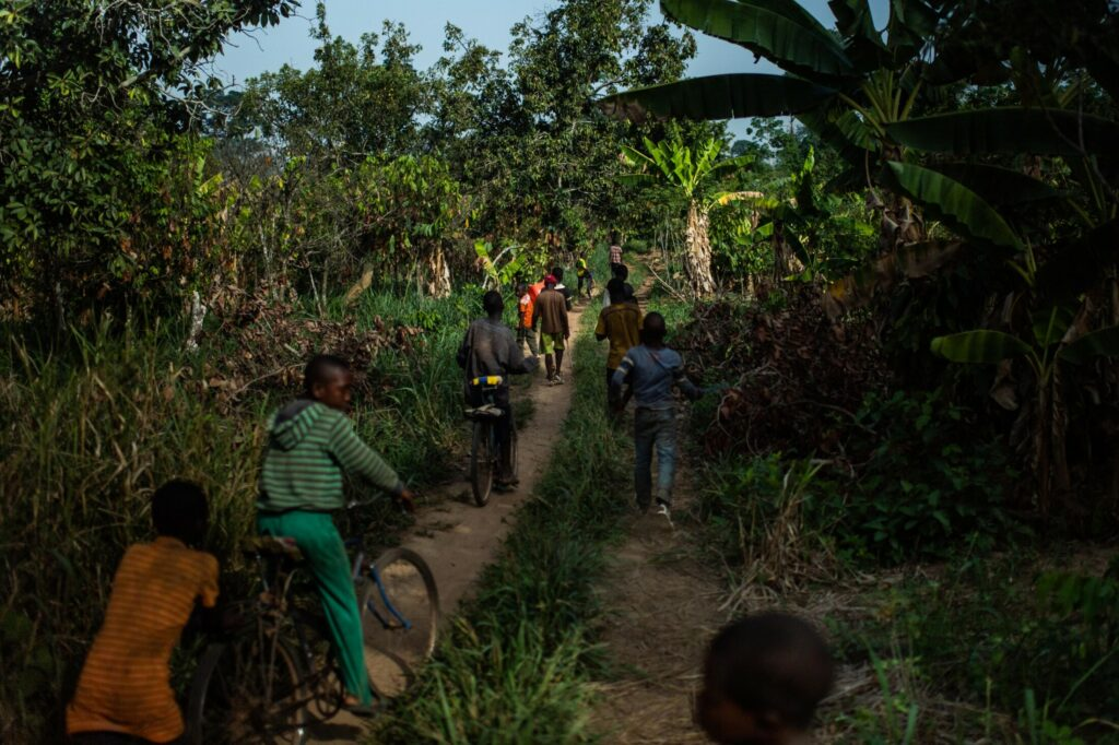 Children leave the cocoa farm at the end of the workday.