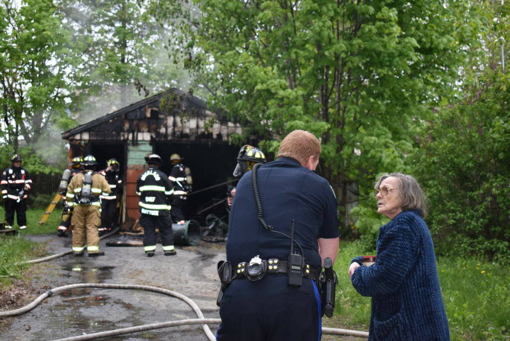 Two teens have been charged with setting a fire that damaged this Rockland garage on May 30.