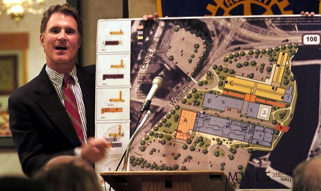 Developer Paul Boghossian holds a drawing of the Lockwood Mills complex in Waterville, including CF Hathaway Co. mill, in a presentation to members of the Waterville Rotary Club in 2008. He has since sold the remaining two Lockwood mill buildings to the North River Company, the current owner of the Hathaway Creative Center.