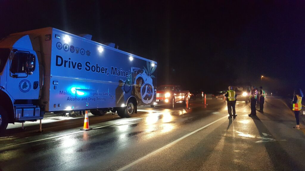 Officials from the Sagadahoc County Regional Impaired Driving Enforcement Team conduct a checkpoint on July 1, 2017, on Route 196 in Topsham.