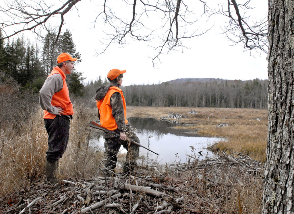 Trevor and Zach Tidd gaze out over a beaver pond while hunting moose in Casco.