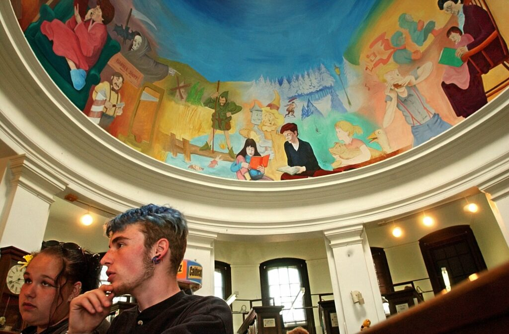 Nicole Denny and Dusty Farnsworth surf the internet at the Pittsfield Public Library.
