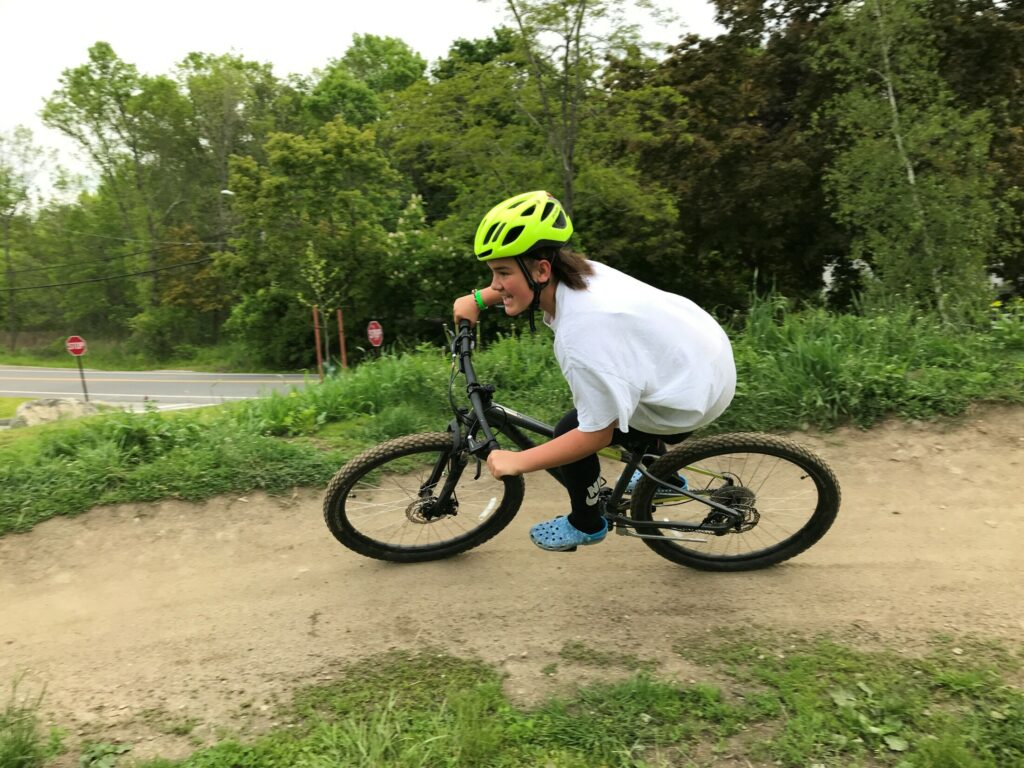 Adryana White leans into a berm at the Bath Pump Track at Bath Middle School in June, when she was a seventh grader at the school.