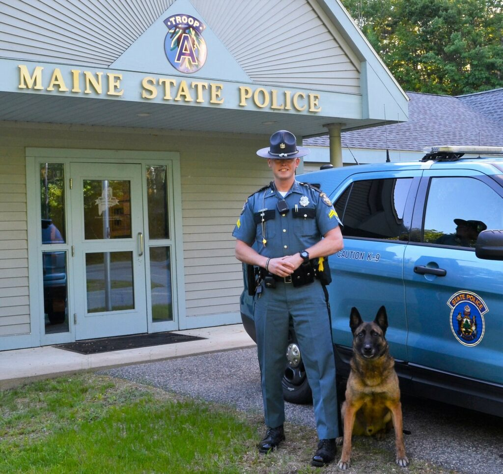 Cpl. Adam Schmidt of Maine State Police Troop A in Alfred, shown with his canine partner, Ibo, was named Trooper of the Year in ceremonies at the Maine Criminal Justice Academy in Vassalboro on Friday.