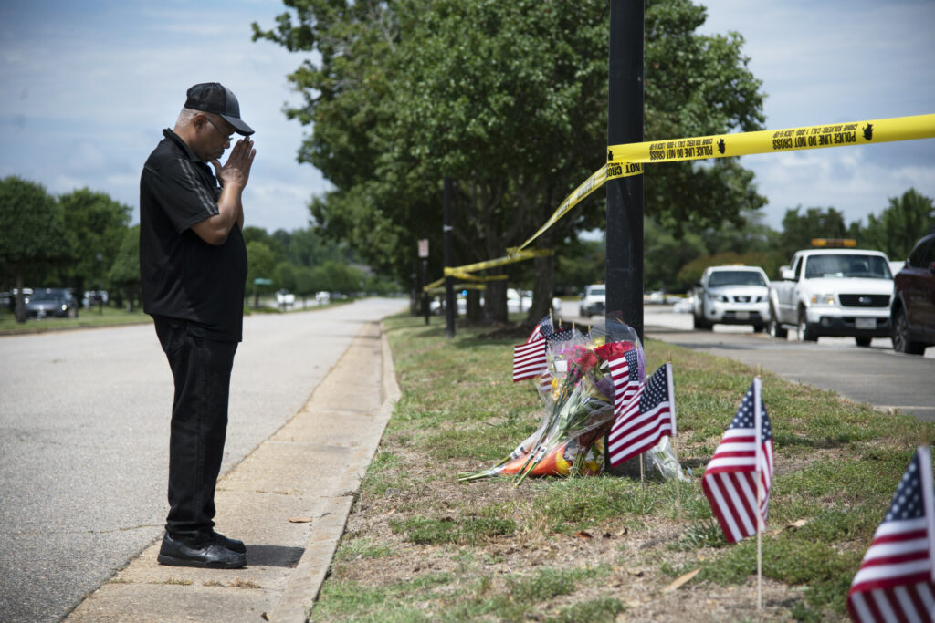 Edmond Maynard pays his respects to the victims of the deadly shooting in Virginia Beach, Va.