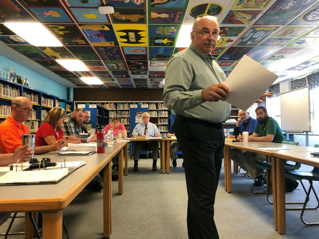 """Construction Manager Peter Pelletier, of Ledgewood Construction, pictured here at a June meeting of the Winslow School Board, said then he expected the district could afford to add the cafeteria back in — as well as all of the """"add-alternates"""" — after bids came in low for the rest of the project."""