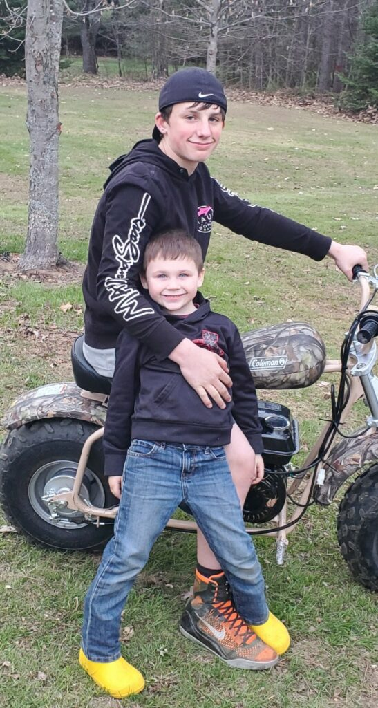 John Hovey IV, 13, of Skowhegan, poses this year with his 5-year-old brother, Jacob Stadig. Hovey died as the result of a dirt bike crash Monday night.