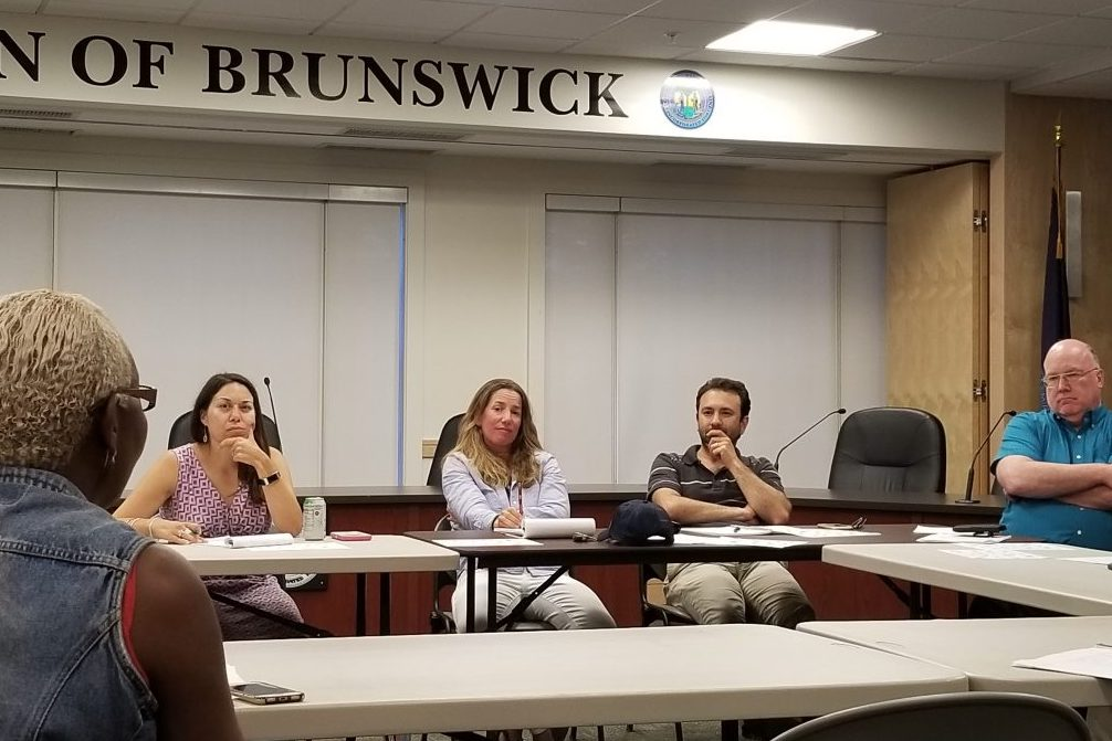 From left, School Board members Celina Harrison and Sarah Singer, Town Councilor Dan Ankeles and Town Manager John Eldridge meet with Mufalo Chitam, executive director of the Maine Immigrants' Rights Coalition. School, town and outside officials met for the first time Wednesday night to start the process of establishing a system to help serve the asylum seekers entering Brunswick.