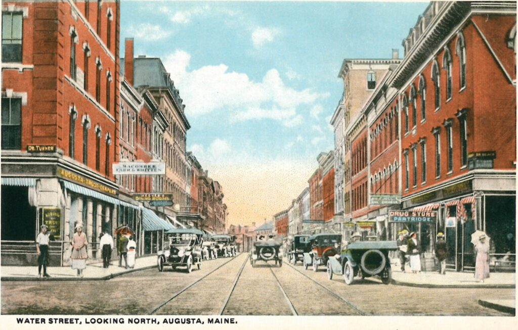 This undated postcard shows two-way traffic on Water Street looking north from Winthrop Street in downtown Augusta.