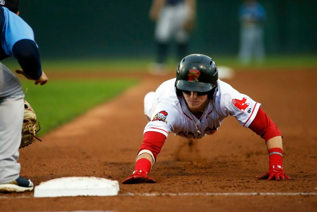 Portland's' Brett Netzer dives back into face on a pickoff attempt during the Sea Dogs' 7-1 win over the Trenton Thunder on Monday at Hadlock Field.