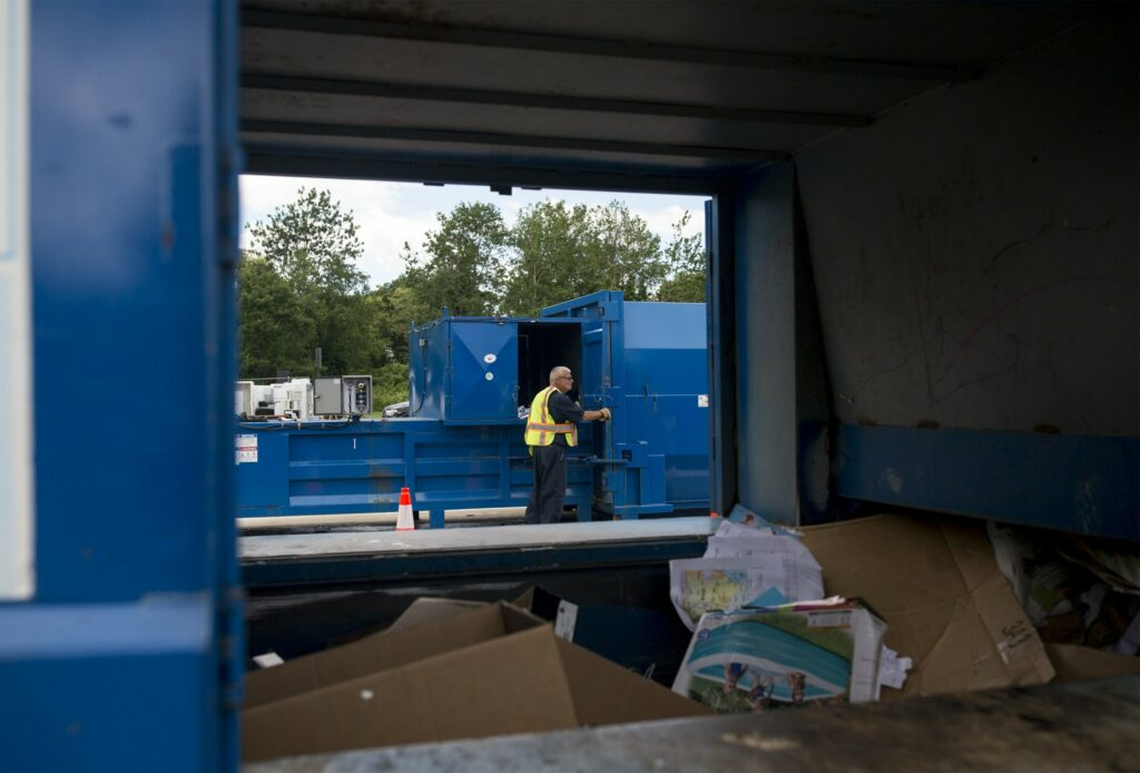 Chuck Catroppo works a compactor at the Cape Elizabeth transfer station on July 1.