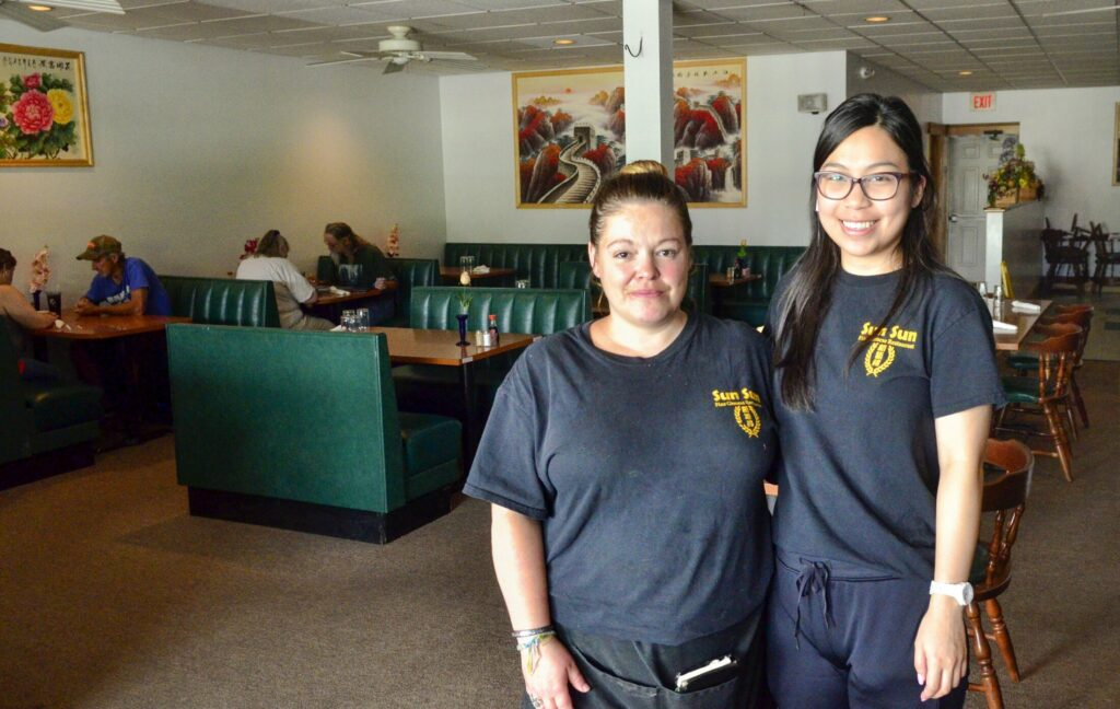 Erin Pushard, left, and Honchi Fung stand by the door Tuesday at Sun Sun Fine Chinese Restaurant in Randolph.