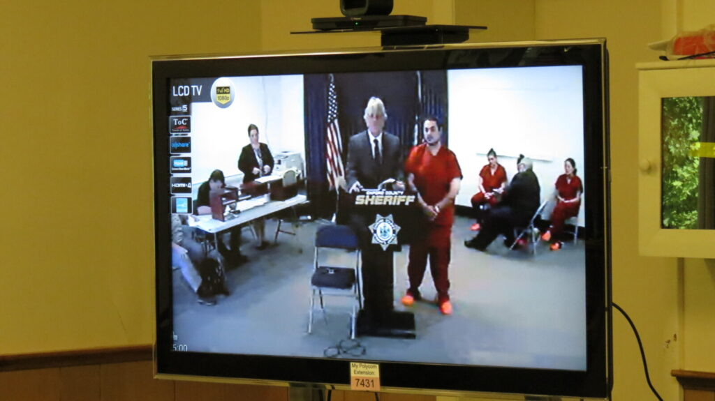 Travis Walker appears Wednesday via video conference before Judge Nancy Carlson at Oxford County District Court. Walker was at the Oxford County Jail in Paris.