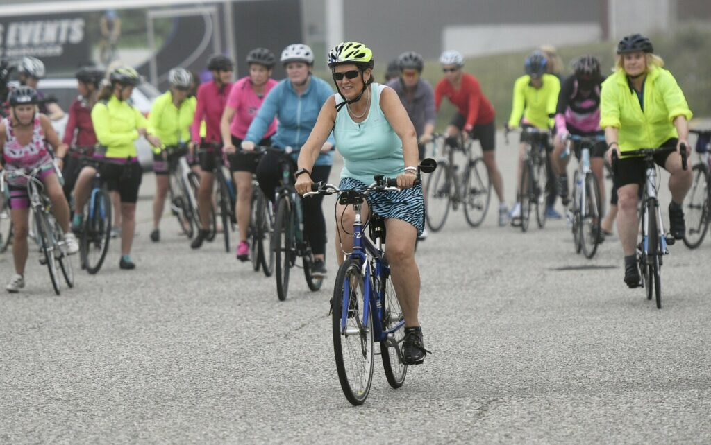Chris Woods, center, of Portland heads out on a training ride in preparation for Sunday's Tri for a Cure with members of her training club Thursday.