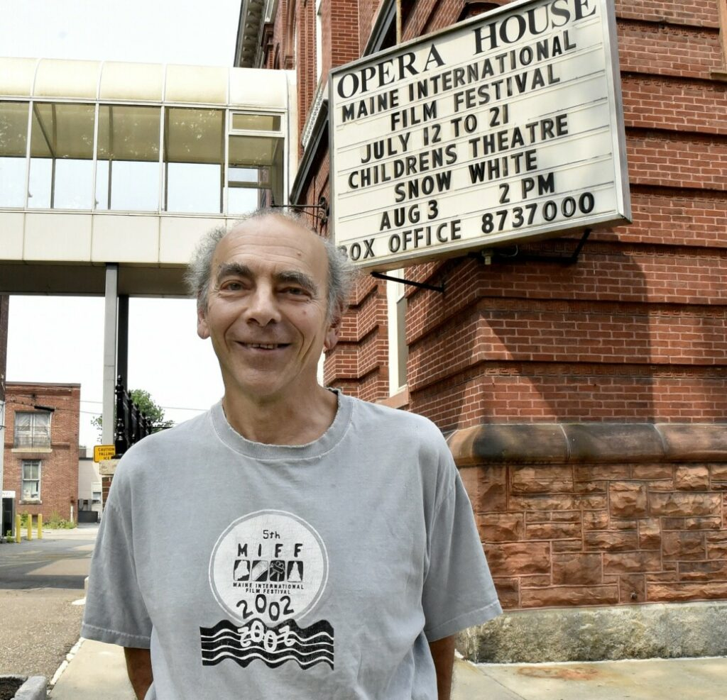 Ken Eisen, programming director for the Maine International Film Festival, stands outside the Waterville Opera House Wednesday where films will be shown during the 22nd annual MIFF.