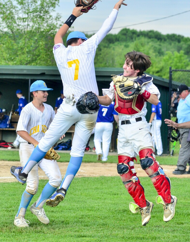 Somerset pitcher/shortstop Mitchell Grant, left, and catcher Joe Ardito celebrate during a 13-15 Babe Ruth state tournament game against Capital Area in Augusta.