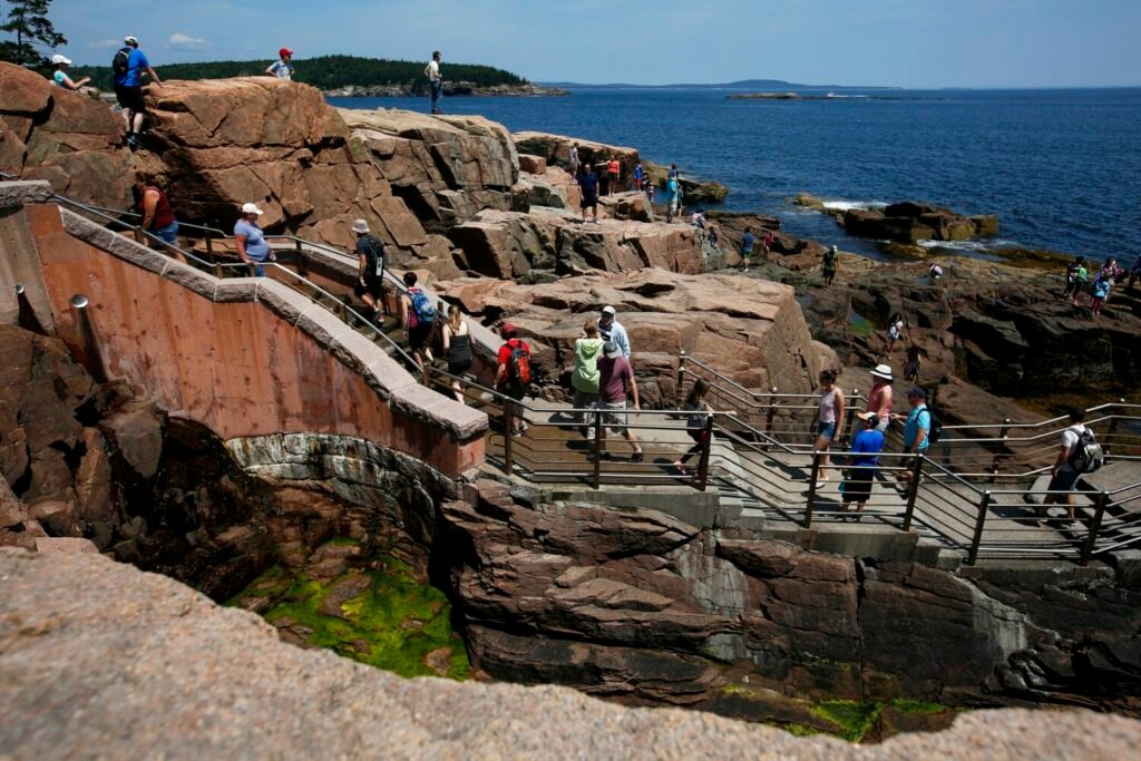 Park visitors fill the stairs and surrounding rock outcroppings at Thunder Hole, one of the most popular spots in Acadia National Park.