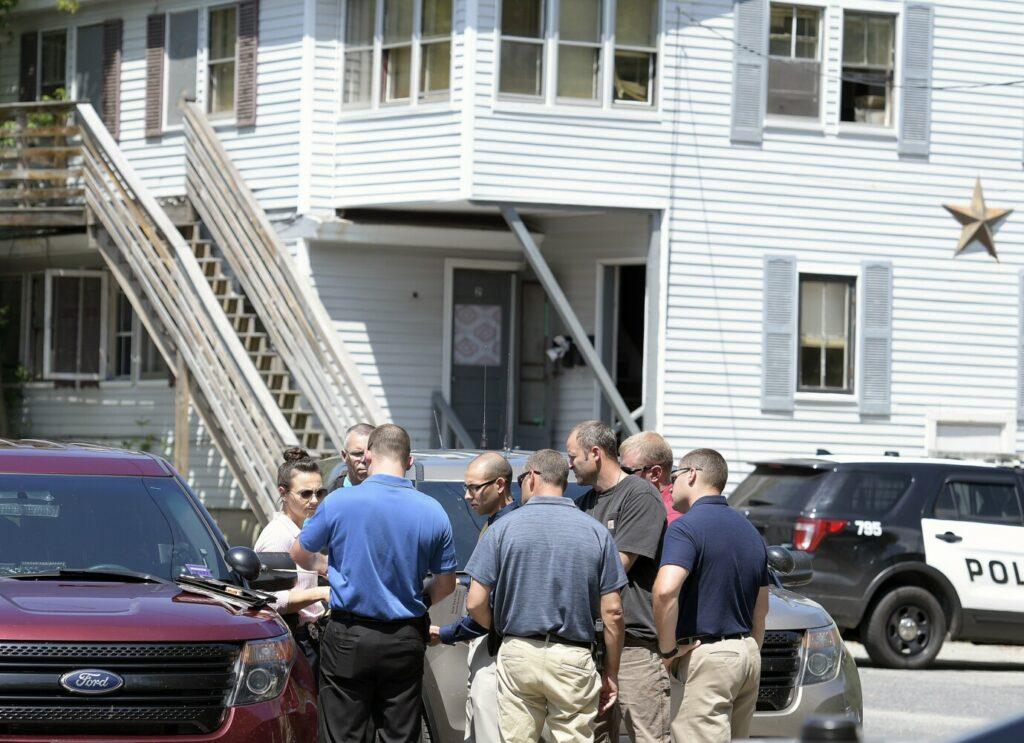 Police congregate Tuesday outside 37 Water St. in Augusta while investigating the death of a woman in the apartment building.