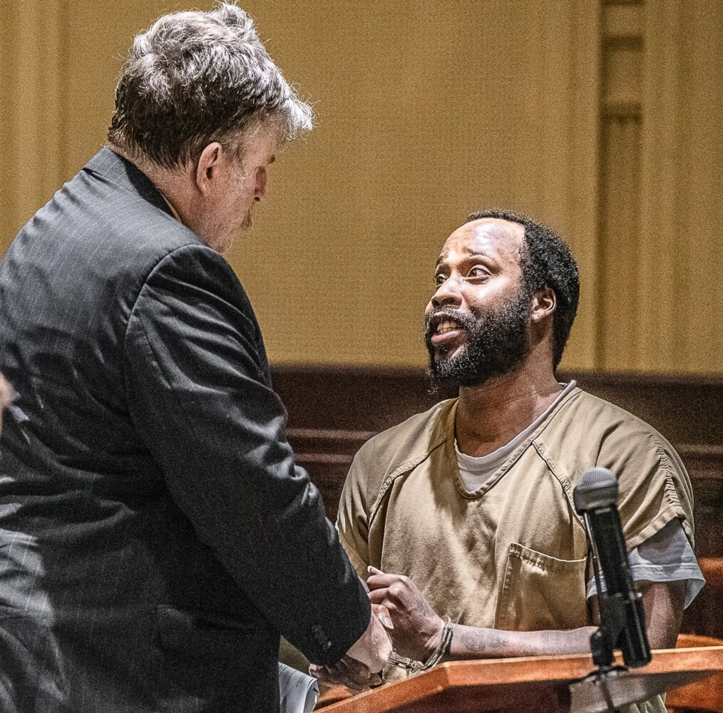 Jamil Dabson of New York City speaks to defense attorney Donald Hornblower after prosecutors dropped a drug charge against him in Androscoggin County Superior Court in Auburn in July.