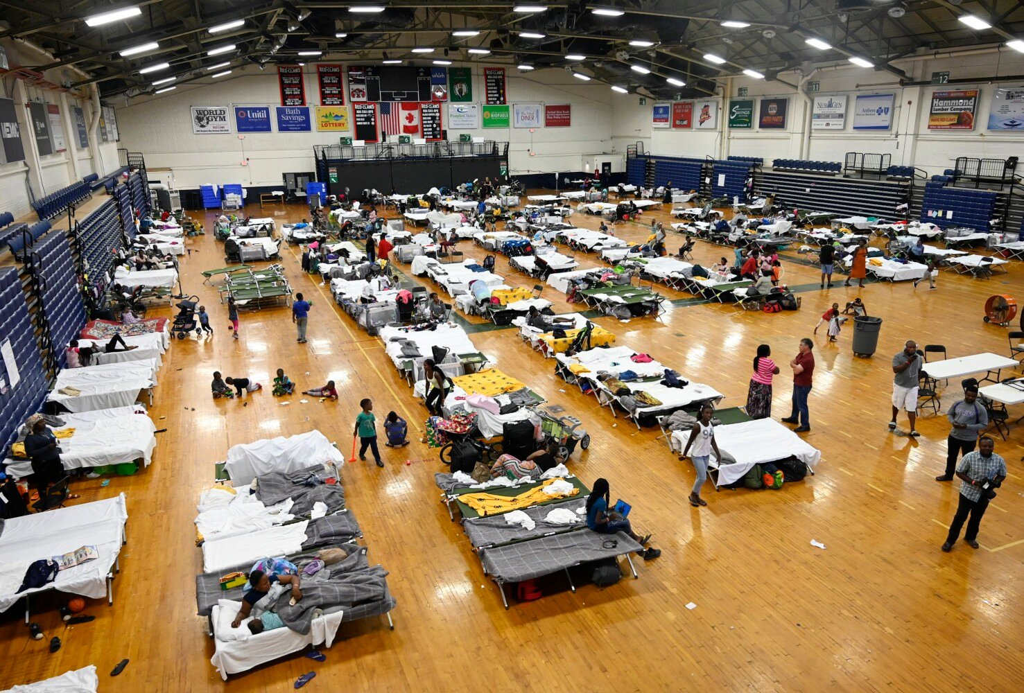 This file photo shows asylum-seekers housed in the city's temporary shelter at the Portland Expo on July 24.