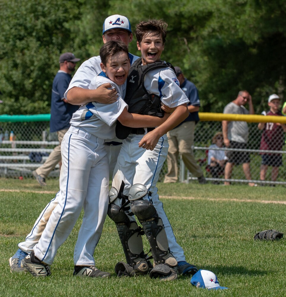 Lewiston relief pitcher Ethan Blue, center, reacts after recording the final out in his team's 8-4 victory over York Saturday at Elliot Avenue Little League Field in Lewiston to capture the state championship and advance to the regional finals in Connecticut where they will take on Massachussetts on Sunday.  Celebrating with Blue are Joe Dube and Mike Caron, right.