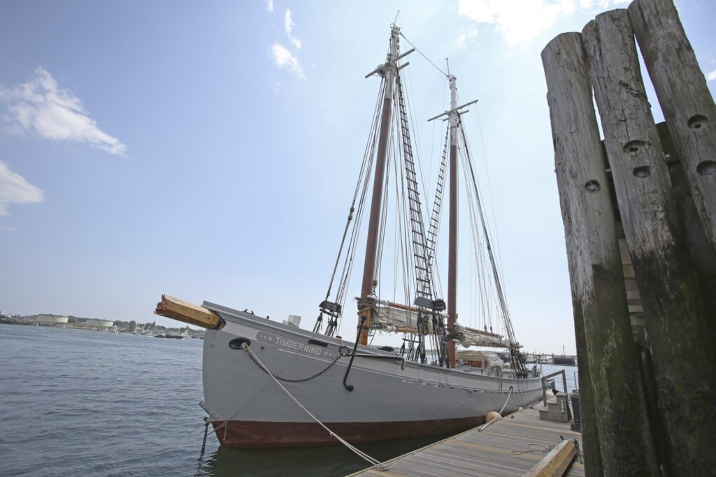 The schooner Timberwind is moored at a pier in Portland on Monday after a collision between the sailing vessel and a lobster boat a day earlier. The broken bowsprit has been replaced.