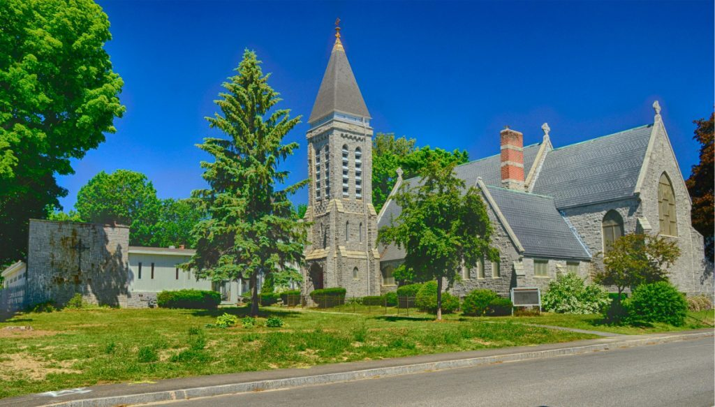 St. Mark's Parish Hall, left, and church in Augusta are seen June 24, 2018. New owner Adam Turner plans to convert much of the property into housing and the stone church into a community space.
