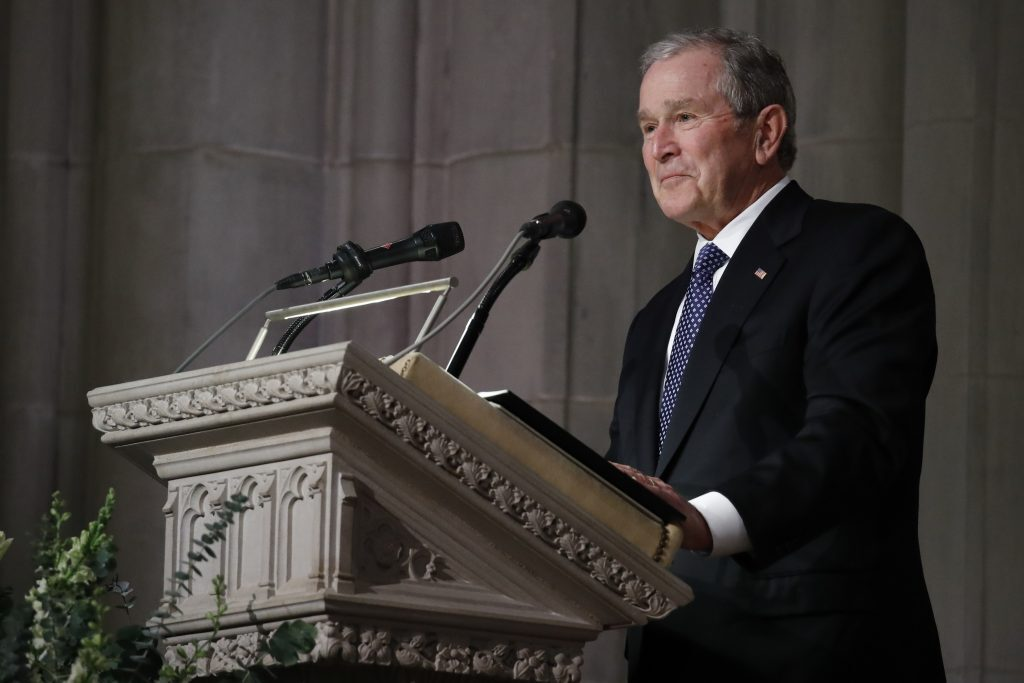 Former President George W. Bush pauses as speaks at the State Funeral for his father, former President George H.W. Bush, at National Cathedral, Wednesday, Dec. 5, 2018, in Washington.