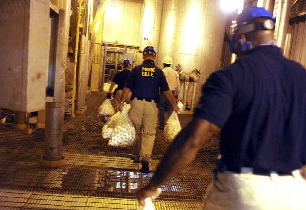 Florida Department of Law Enforcement officers carry bags of prescription drugs that were confiscated from a clinic to be burned in an incinerator facility in Coconut Creek in 2011.