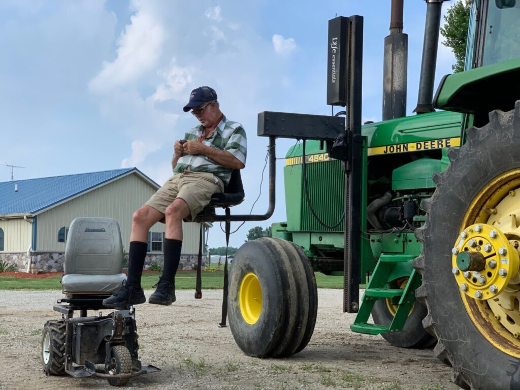 Farmer Mark Hosier, 58, uses a lift to get into a tractor on his farm in Alexandria, Ind., earlier this month. Hosier was injured in 2006, when a 2000-pound bale of hay fell on him while he was working. Assistive technology, help from seasonal hires and family members, and a general improvement in the health of U.S. seniors in recent decades have helped farmers remain productive and stay on the job well into their 60s, 70s and beyond.
