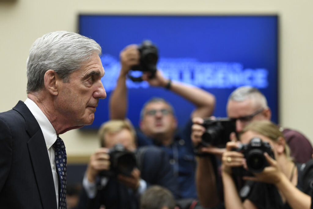 Former special counsel Robert Mueller returns to the witness table after a break in his testimony before the House Intelligence Committee on Wednesday.