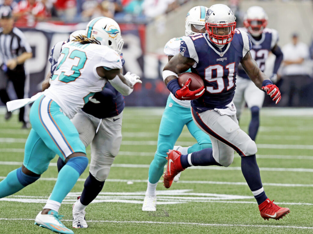Linebacker Jamie Collins returns an interception last year when playing with the Patriots. Now in Detroit, Collins expects the team to contend right away.