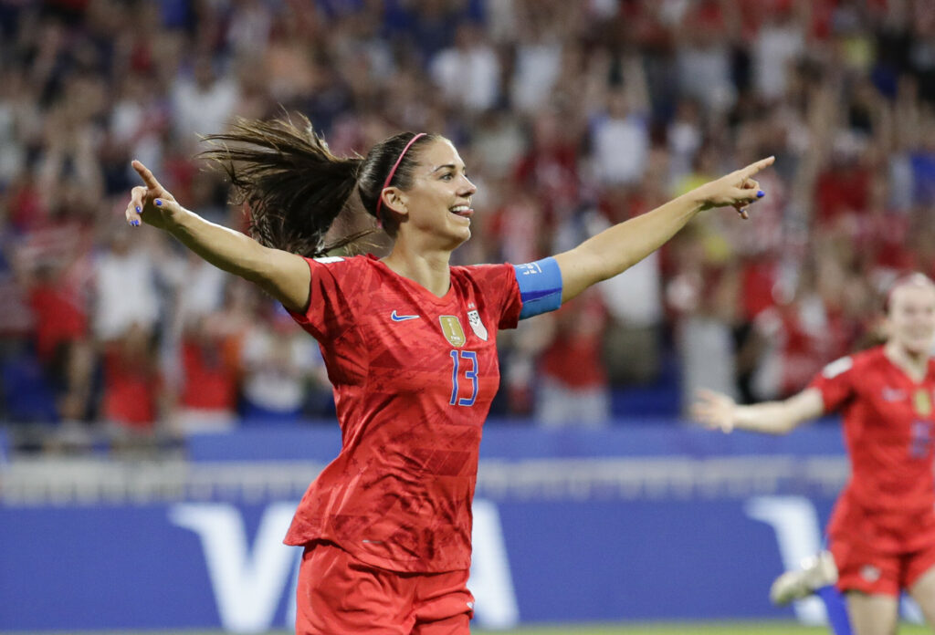 Alex Morgan celebrates after scoring the go-ahead goal in the semifinals of the Women's World Cup on Tuesday in Lyon, France. The U.S. beat England 2-1 to advance to the final.