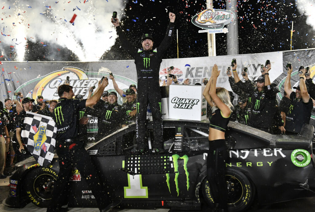 Timothy D. Easley/Associated Press Kurt Busch celebrates his hold off his brother, Kyle, to win the NASCAR Cup Series race on Sunday at Kentucky Speedway in Sparta, Kentucky.