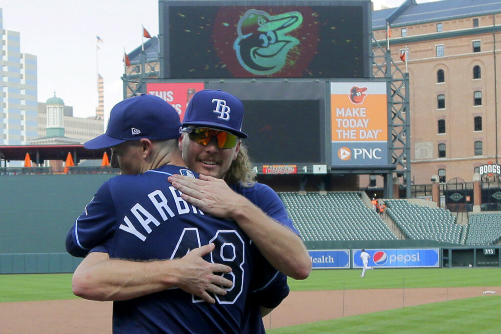 Tampa Bay pitchers Ryan Yarbrough (48) and Ryne Stanek embrace after the Rays beat the Baltimore Orioles 4-1 on Sunday in Baltimore.