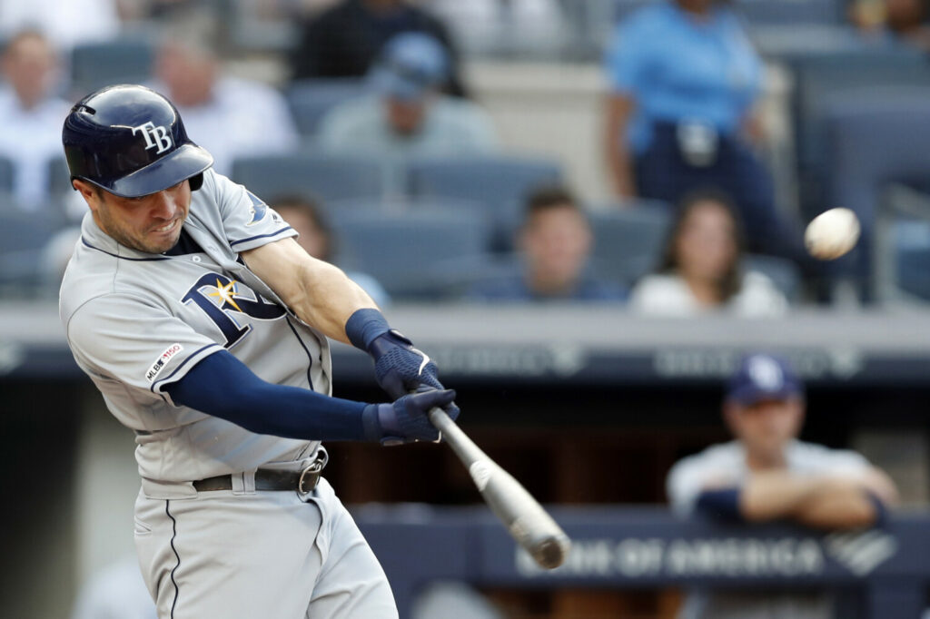 Tampa Bay's Travis d'Arnaud hits one of his three home runs in the Rays' 5-4 win over the New York Yankees on Monday in New York.