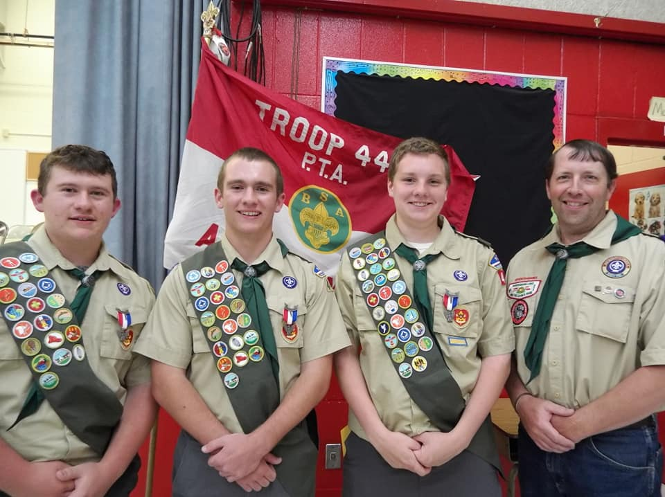 Eagle Scouts from left are Jonathan Roy, Michael Roy and Seth Pellerin, with Scoutmaster Mathew Dow Sr.