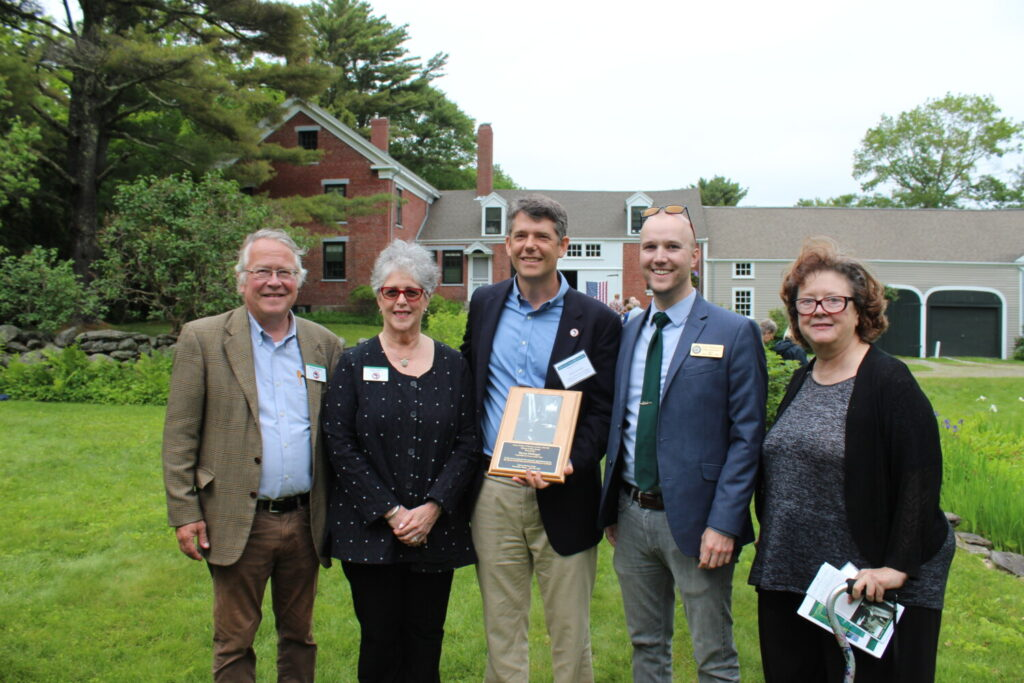 To a standing ovation, Steven Hufnagel, executive director of Coastal Rivers Conservation Trust, accepted the Frances Perkins Center Partners in Place Award on June 26. From left are Michael Chaney, Francis Perkins Center executive director; Sarah Peskin, FPC board chairwoman; Steven Hufnagel; and Scott Wilkinson and Andrea Quaid, regional representatives for US Sen. Angus King.